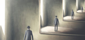 figure of a man reflected inside a mirror inside a mirror