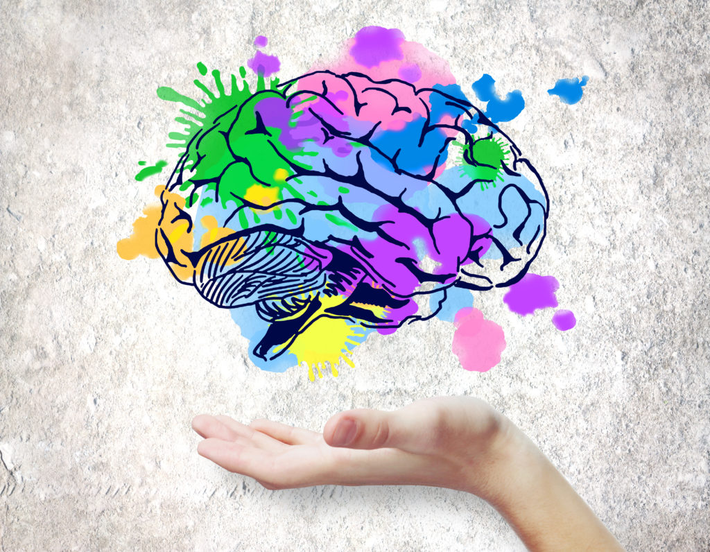 abstract colorful image showing a hand under a brain